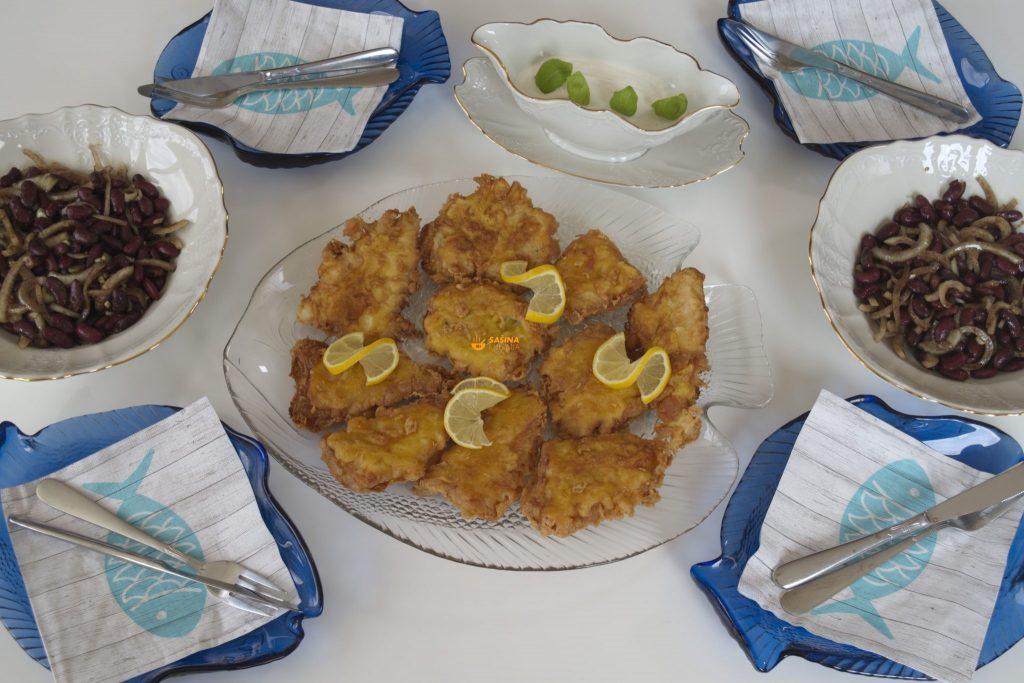Fileti Oslića u pivskom tijestu Grah salata sa bučinim uljem